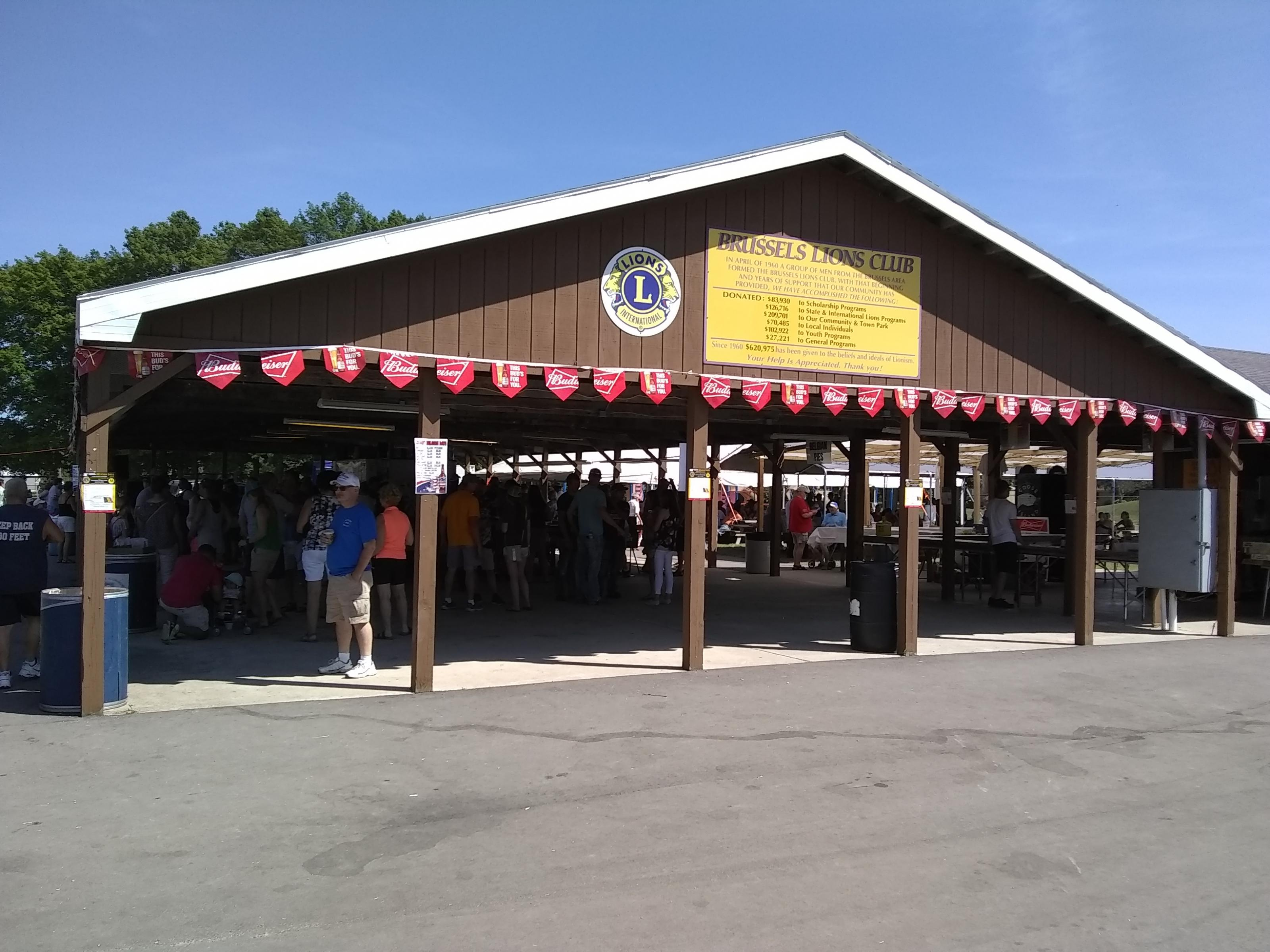 Food and fun underneath the Brussels Lions Club shelter at Belgian Days